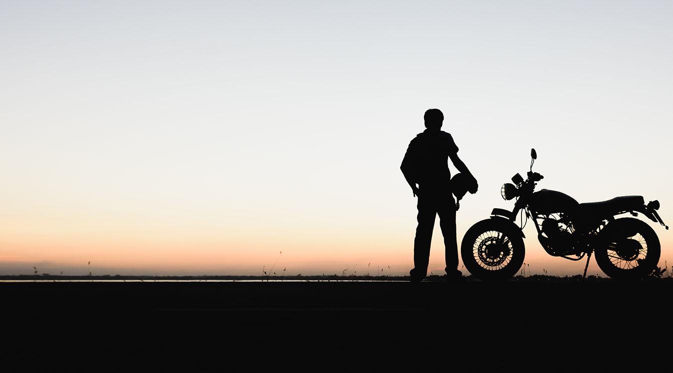 Biker man and motorcycle