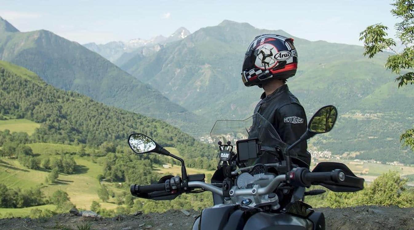 motorcyclist wearing white helmet
