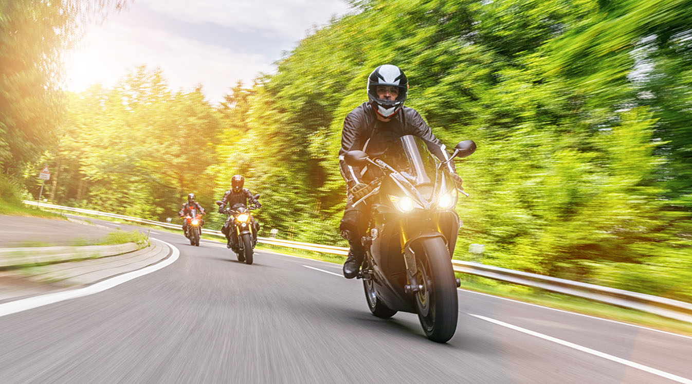 bikers riding on empty road