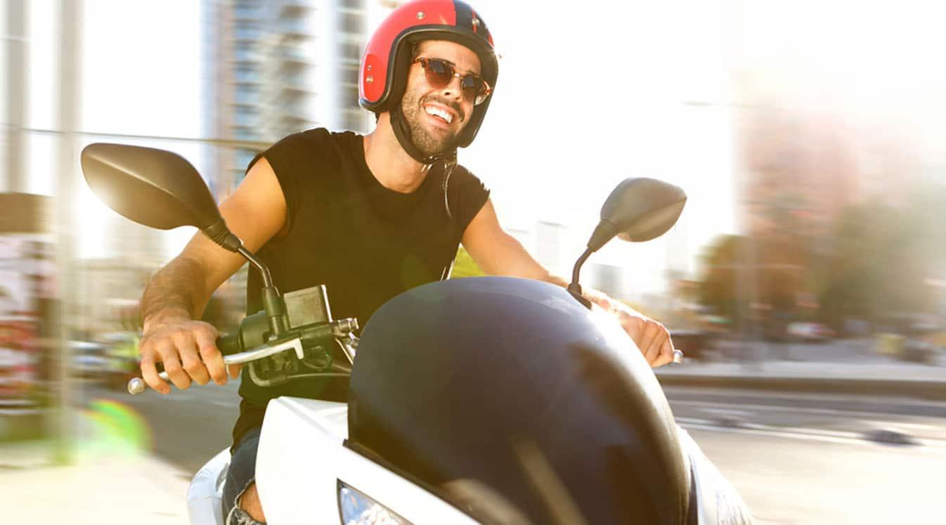man smiling on motorcycle