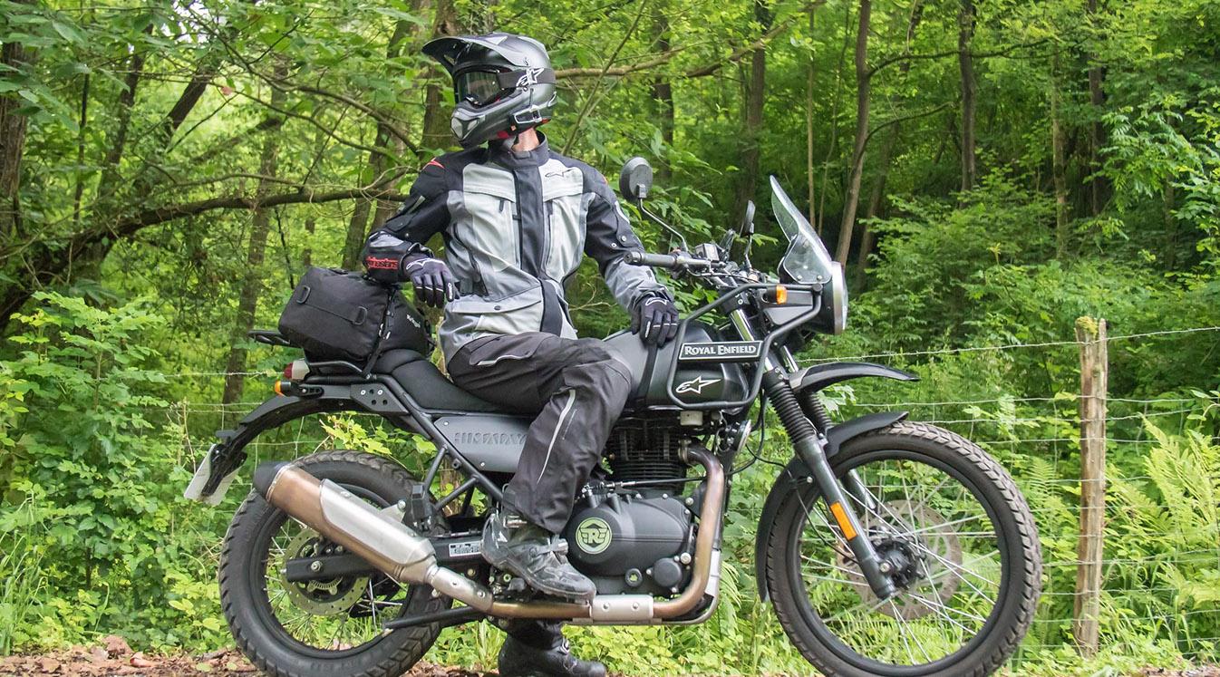 Man looking behind him on Motorcycle