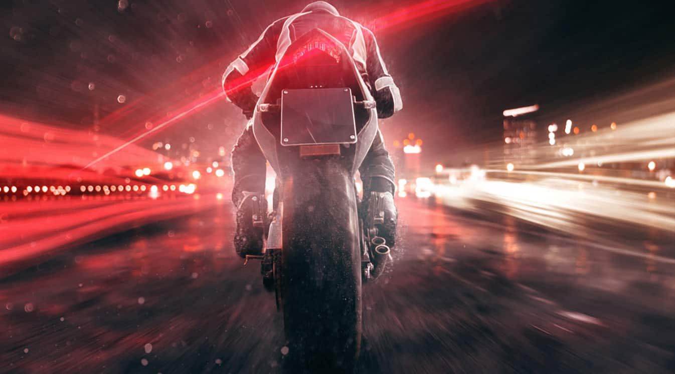 bike riding through fast traffic