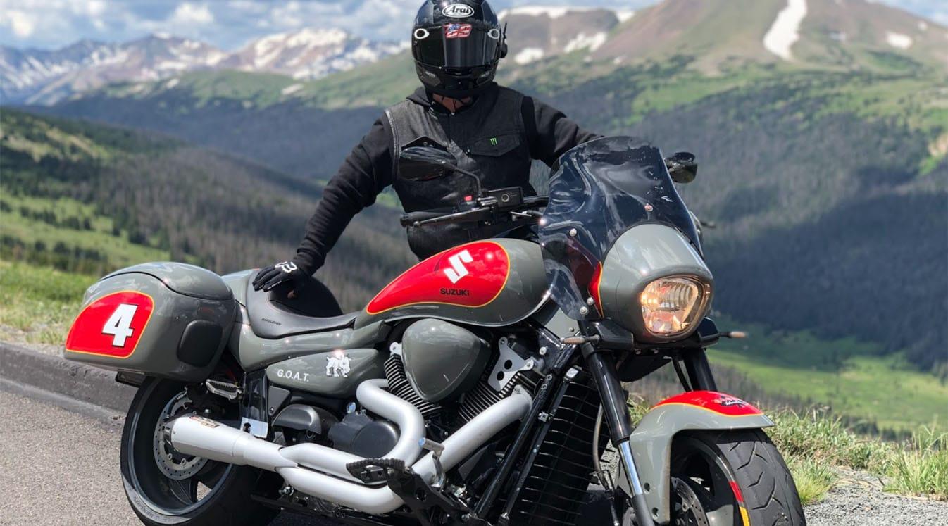 biker parked on mountainside