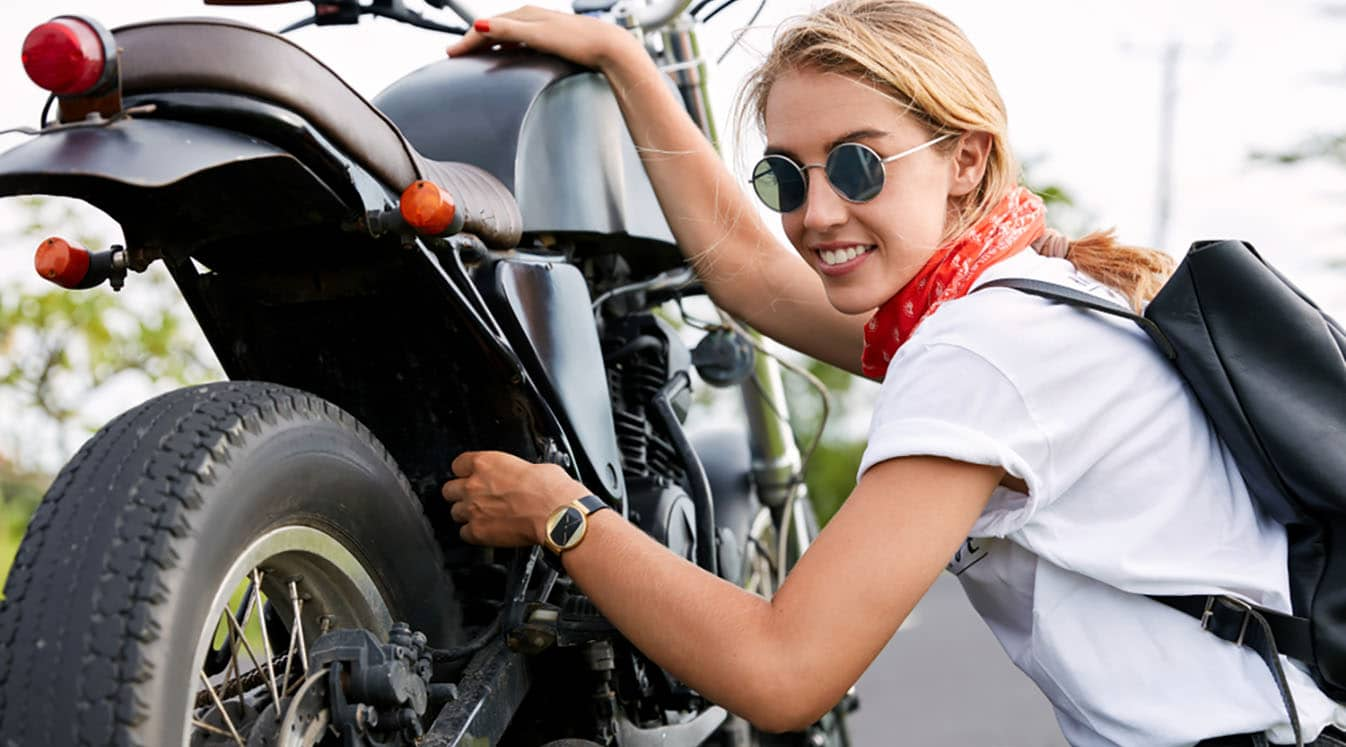 portrait woman with motorcycle